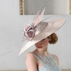 Heather hat by Jane Taylor Millinery, £1,285. I know, I know, it's an absurd amount of money for a hat, but it's so beautiful! It's like something from the front cover of a Penny Vincenzi novel! In a good way!