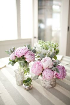 love the peonies, sweet peas, dusty miller, and succulents for foral centerpeice