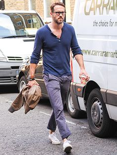 STEPPING OUT | Ryan Reynolds takes a stroll through London on a 75-degree afternoon.