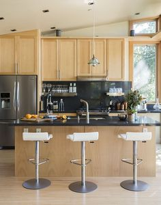 Kitchen with custom birch cabinetry and a Caesarstone Raven countertop