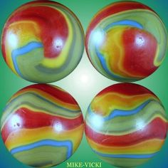 """Four views of one strikingly colored and patterned early Akro Agate shooter marble, 3/4"""" diam."""