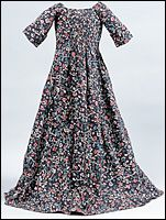 YOUNG GIRL'S DRESS OF BLOCK-PRINTED COTTON  British, ca. 1780–90, This simply styled dress with a high-waisted bodice is gently fitted with small tucks front and back that allowed for growth. The eminently practical fabric choice of a colorful, washable cotton was a sensible concession to the needs of an active young girl.