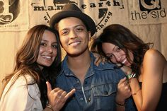 From left to right, Jaime Kailani (founder of m.a.m.a. earth), brother Bruno Mars and sister/bandmate Tiara Hernandez.
