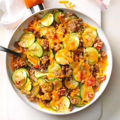 Zucchini & Sausage Stovetop Casserole Recipe -Gather zucchini from your garden or farm stand and start cooking. My family goes wild for this wholesome casserole. We like our zucchini grated, not sliced. —LeAnn Gray, Taylorsville, Utah