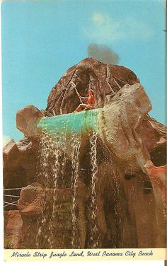 "Tiki girl atop the waterfall on the volcano at Jungleland, on the ""Miracle Strip"",  US98.   West Panama City Beach, Florida. 1960's"