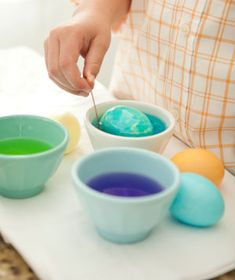 Marbelized Eggs - Oil & Water Don't Mix Which Is Great For This Eggs-ellent Project.  1.Start with Dry Coloured Eggs. 2.Add 1 tablespoon of vegetable oil to one of the cups filled with a dark colored dye. Run a fork through the mixture.  3.Dip egg into cup and re-dye it in the oil mixture, turning the egg often with a spoon.  4.Carefully remove the egg. Set it aside to dry on a paper towel.