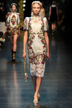 Dolce and Gabbana.  I love the vintage feel of this dress.  The fabric reminds me of cards from the turn of the century.