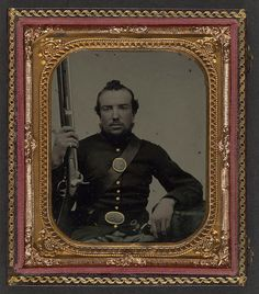 [Unidentified soldier in Union uniform with eagle breast plate holding a musket and bayonet in scabbard] (LOC) by The Library of Congress, via Flickr