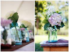 Hydrangeas in blue mason jars.