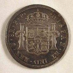 Description: A nicely toned extremely fine or much better 1798 PTS PP Bolivian silver coin. This is the Carolus IIII 8 Reales depicting the bust of King Charles