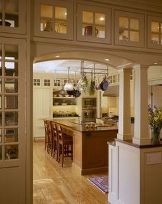 One way to support structure and disguise supports, with storage above, built in's in the arts and crafts style kitchen.