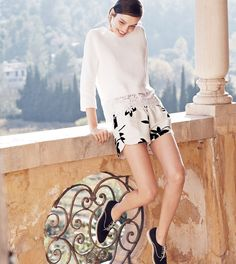 J.Crew women's eyelet panel sweater, linen pull-on short in flora, and piped suede loafer shoes.