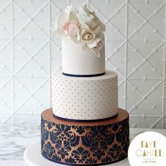 Just had to share this beautiful three tier ivory and rose gold with navy damask Wedding Cake for Annette and Anthony. Super Sophisticated! #FayeCahillCakeDesign