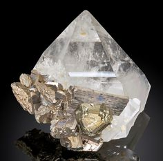 Stannite crystal with Arsenopyrite atop a transparent Quartz