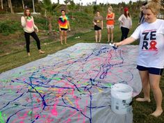 Paint slip n' slide! I want to do this!! everyone should wear white t-shirts! - except I would SO do this in my white dress! Could you imagine the pictures? It's capture my personality perfectly. <3