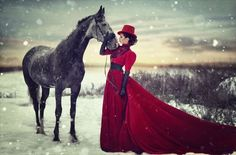 Victorian Woman in Red with Horse (From 'Walking in a Winter Wonderland') - For costume tutorials, clothing guide, fashion inspiration photo gallery, calendar of Steampunk events, & more, visit SteampunkFashionGuide.com