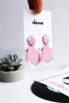 Unique statement earrings in pink and silver, handcrafted from a vinyl record by Anne-Louise Laflamme of Dana Jewellery. Silver Earrings, Stud Earrings, Valentines Jewelry, Jewelry Design, Unique Jewelry, Statement Jewelry, Vinyl Records, Jewelry Collection, Metallic