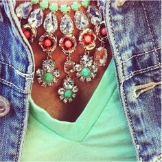 Love the statement necklaces with mint t-shirts