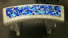 Here is one of my stained glass cement benches. Color all year round for the garden.