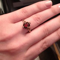 Antique Rose Gold Victorian Garnet Seed Pearl Ring A beautiful all original victorian ring c. 1890 that features a genuine garnet gemstone and four natural seed pearls.   Jewelry Specs Shank Width: 1.25mm Weight: 1.5 grams Size: 8.25-8.5 US Metal Type: 10K Rose Gold Stamped: Unmarked, has been tested Condition: Very Good Vintage Condition, some metal wear to shank  Center Gemstone Specs Stone: Garnet Approx. Carat Weight/Size: 5.5x3.5mm Cut Type: Oval Faceted Color:Pinkish  Red Clarity: Eye…