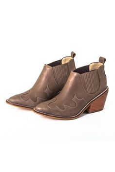 31345338a Leather ankle boots with a slit back pull tab for easy entrance and elastic  side panel. Shoptiques