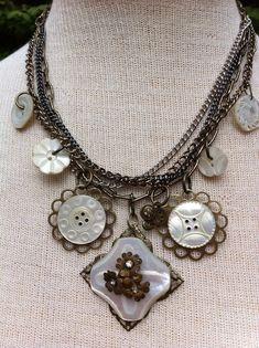 Hey, I found this really awesome Etsy listing at http://www.etsy.com/listing/152379729/antique-button-statement-necklace-carved