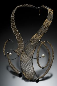 Neckpiece | Lauran Sundin.  Wire Bobbin Lace working with 14 & 22k gold, and sterling silver.