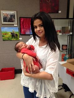 """{ Selena Gomez } """"hi! I'm Selena. I'm 18. I love singing. This is my 7 month old baby girl, Brynn. { older is Lauren Orlando or Brynn Rumfallo and Dove Cameron. } I'm a full time mom, since Brynn's dad left me before I was born. Intro?"""""""