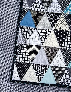 It was a week of marathon sewing and quilting to complete this black and white triangle quilt before I left for my Easter travels. When I f...