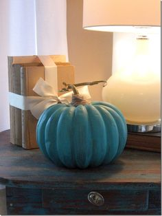 spray painted with turquoise (cheap pumpkin from Walmart) wrapped the stem with twine