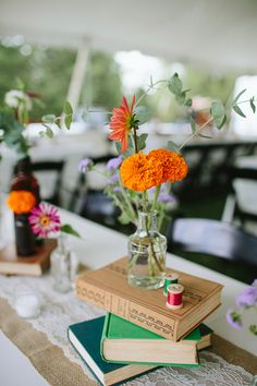 book + floral centerpiece, photo by Brooke Courtney Photography http://ruffledblog.com/shenandoah-valley-wedding #weddingcenterpieces #centerpieces