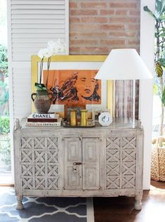 Antique spanish chest, a saladino-inspired cylinder lamp, and framed artwork from an old edition of Neiman Marcus, by (La Dolce #office design #hotel interior design #interior design office| http://design-bedrooms.lemoncoin.org