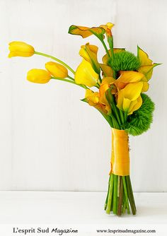 Bright clutch bouquet of yellow calla lilies, tulips, and green dianthus. March Wedding Flowers, Small Wedding Bouquets, Yellow Wedding Flowers, Floral Wedding, Yellow Weddings, Bouquet Wedding, Wedding Decor, Wedding Dresses, Yellow Flower Arrangements