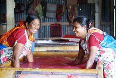 Renu Begum (left) and Malina Sarkar (right) making silk paper for Prokritee in Bangladesh