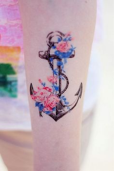 A different take on an anchor tattoo. I love the colors of the flowers and vine.