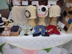 Look at the crochet table cover.  What a great way to show off the crochet items for sale.