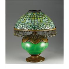 An American Leaded Glass Blown-Out Table Lamp Tiffany Studios, New York, New York Circa Leaded glass, - Available at 2006 October Decorative Art. Louis Comfort Tiffany, Victorian Lamps, Antique Lamps, Antique Lighting, Tiffany Lamps, Tiffany Art, Tiffany Jewelry, Stained Glass Lamps, Leaded Glass