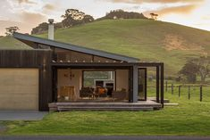 This Northland bach creates a relaxed holiday environment through casual planning and the use of a palette of natural timbers both inside and out