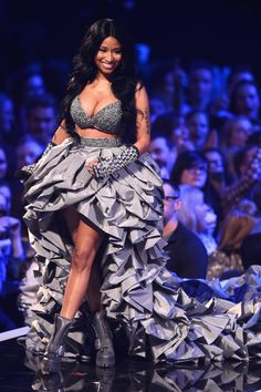 Pin for Later: The Year's Best Award Show Snaps  Nicki Minaj's cleavage stole the show on stage at the MTV EMAs.