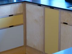 cut-out handles in birch plywood cabinets