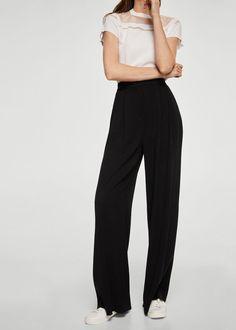 Droit Tissu fluide Taille haute Deux poches latérales Passants pour la ceinture Fermeture Éclair avec crochet