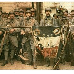 French soldiers carrying their flag After Heavy fights with the germans, 1916/17. ww1