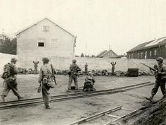 Execution scene during the liberation of Dachau concentration camp. Soldiers of the 157th Infantry Regiment of the 7th U.S. Army shoot the SS Guards, 29th April 1945.