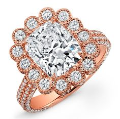 Scallop ring with cushion brilliant center diamond accented with white diamond melee in 18k rose gold.