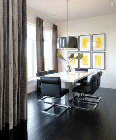 Artwork: In a neutral space, artwork can add just enough color to catch the eye. A gallery wall with identical or similar pieces will reinforce a fun accent color — in this case, yellow.