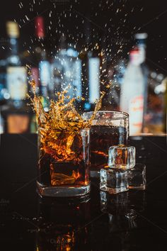 two glasses of whiskey on a blurred background bar by ruslan117 on @creativemarket