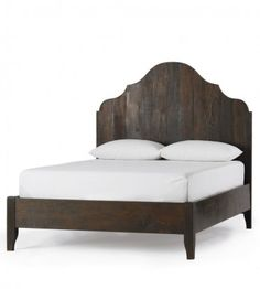 I love the rustic material combined with the classic lines of this bed. Dreamy.