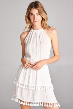 Key West Dress – Penelope Sage- This is the perfect summer dress or the cover up for a beach vacay! It has a linen-like material and a tiered tassel hem. The elastic waistband and tie at the back make for a comfortable fit.