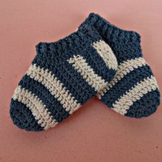 How To Crochet Stripy Baby Socks - DIY Crafts Tutorial - Guidecentral. Guidecentral is a fun and visual way to discover DIY ideas learn new skills, meet amazing people who share your passions and even upload your own DIY guides. Crochet Sock Pattern Free, Crochet Slipper Pattern, Quick Crochet, Newborn Crochet, Crochet Baby, Toe Up Socks, Diy Baby Socks, Easy Crochet Slippers, Knitting Patterns