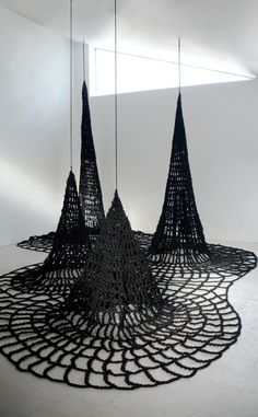 """""""Surface Tension"""" by Alisa Dworsky. Black Polyester Hand-crocheted rope, River Stones, Carabeeners, dimensions variable, 2011"""